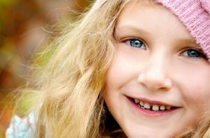 Young girl with blonde hair smiling