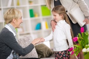 Little girl introduction her new babysitter