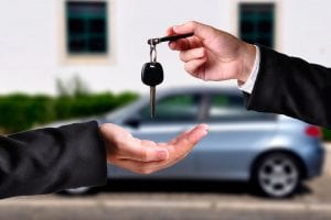 hand giving car keys to foster care teen