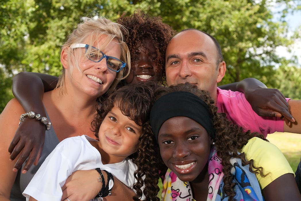 Happy multi-ethnic foster family